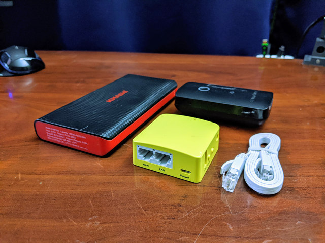 The GL.iNet Mango with my phone, Kmashi USB battery, and my old RavPower FileHub Plus
